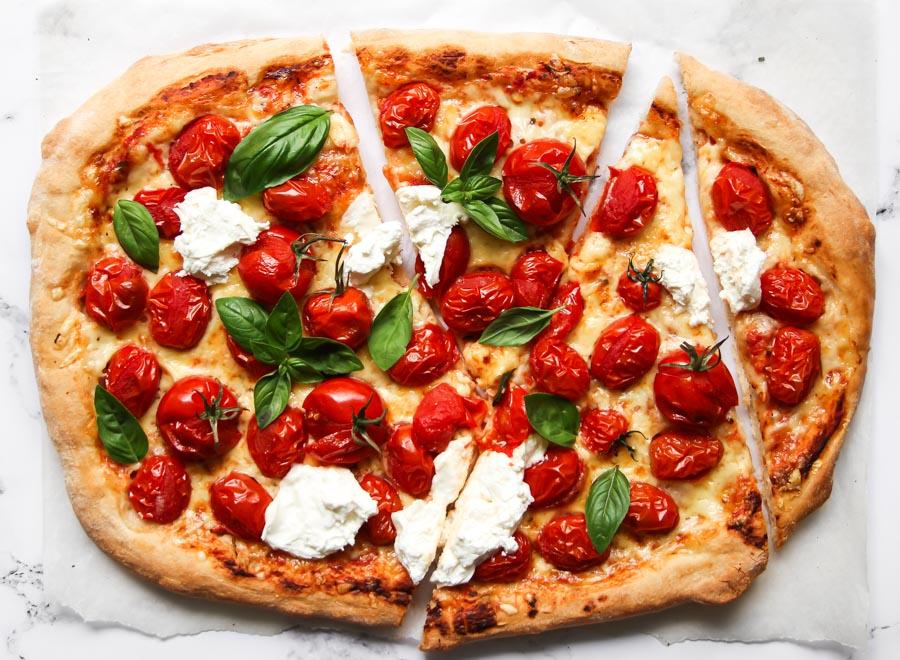 Sliced cherry tomato pizza with burrata